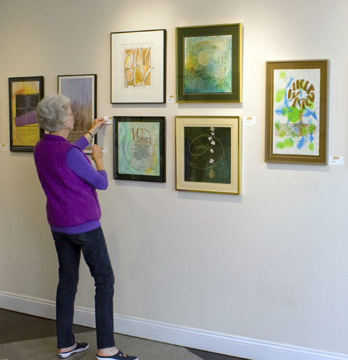 image of Erika Woods hanging art